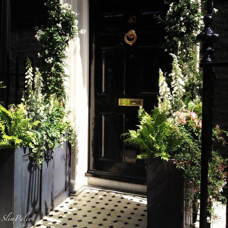 High gloss Black door + brass hardware. Mayfair, London