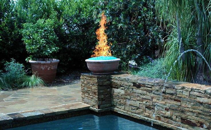 Fire glass fire bowl at corner of pool awesome places - Pool fire bowls ...