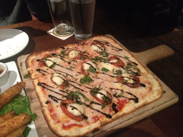 Margherita pizza: Oven dried tomato slices, fresh chopped basil, mini ...