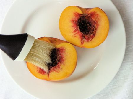 Grilled Peaches with Toasted Almonds and Balsamic Glaze.