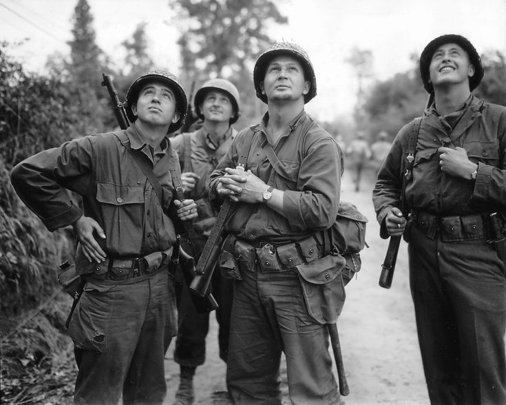 Four US Army soldiers watching Allied bombardment, Saint Lo, France, Jun 1944