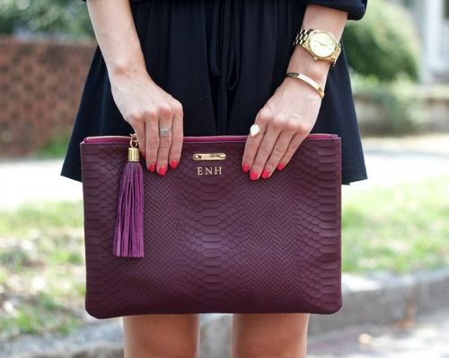 Plum snakeskin envelope clutch.