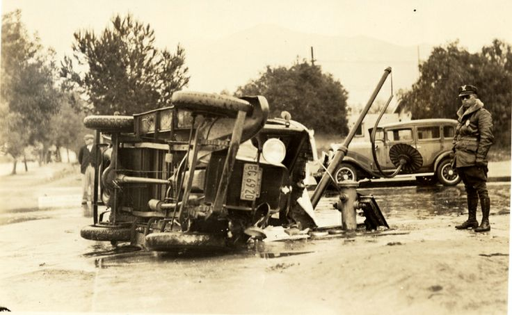 A car takes out a lamp post in an accident on the rain-soaked streets of Glendale, circa 1930s. Photographed by the Glendale Police Department. Be careful out there. Glendale Central Public Library. San Fernando Valley History Digital Library.