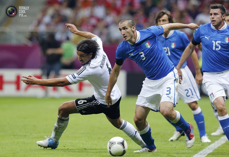 Germany's Khedira challenges Italy's Chiellini during their Euro 2012 semi-final soccer match at National Stadium in Warsaw. THOMAS BOHLEN/REUTERS