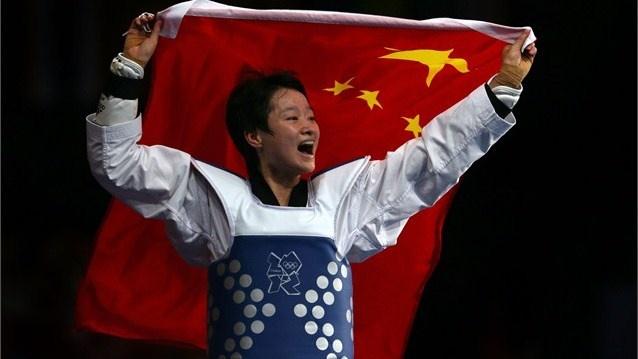 Jingyu Wu of China celebrates victory in the Women's -49kg Taekwondo Final match against Brigitte Yague Enrique of Spain on Day 12.