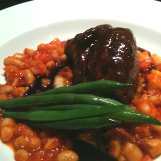 ... lamb shank on slow cooked white beans and tomato ragu with lamb jus