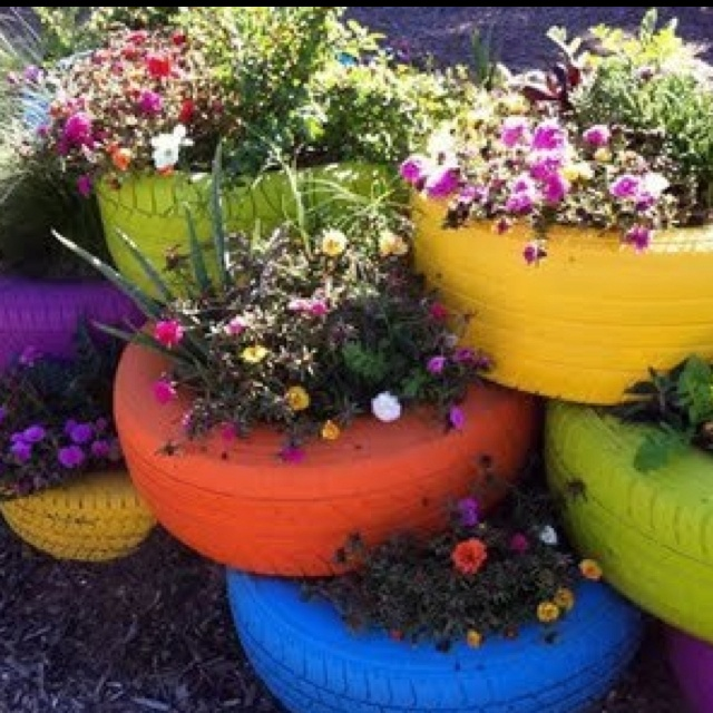 Painted tire planters outdoor things pinterest - Painted tires for gardens ...
