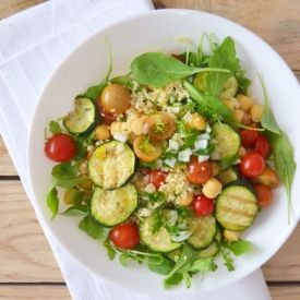 Couscous salad with chickpeas, grilled zucchini, cherry tomatoes and ...