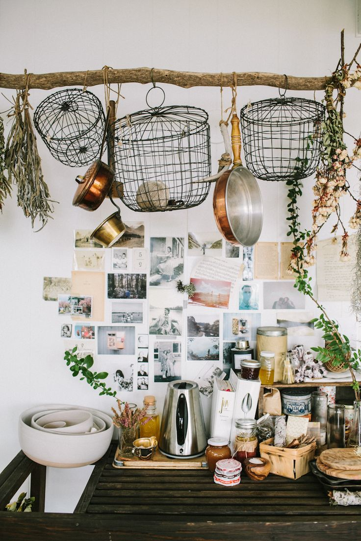 A lived-in kitchen with a DIY driftwood pot rack/herb drying rack, photographed by Woodnote Photography. #LocalMilk