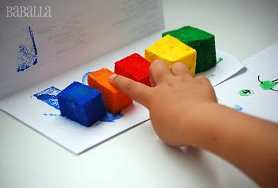 Sponges soaked in finger paint. Stops children from scooping huge balls of paint on their paper! GENIUS!