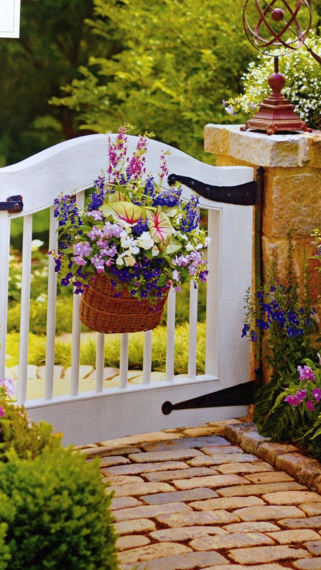 Flower Baskets On Fence : Garden gate with hanging basket gardening
