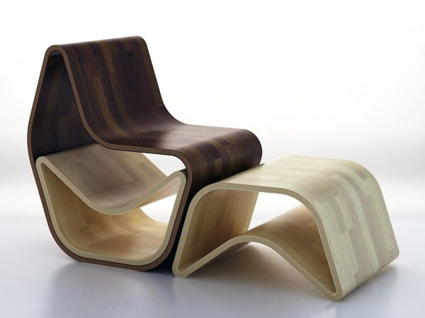 GVAL chair – Stores two ottomans inside itself.