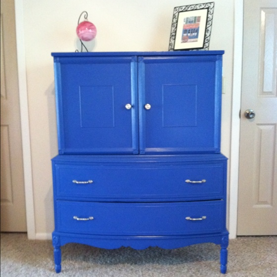 My sister's neighbor was throwing out a sadly beaten up old armoire I stripped the paint off, my dad put new shelves inside, I found a gorgeous French blue, new hardware, and here is the final product. So proud of how it turned out.
