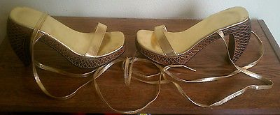 WOMENS GOLD TIE UP SHOES WITH DESIGNED WOOD CARVED HEELS