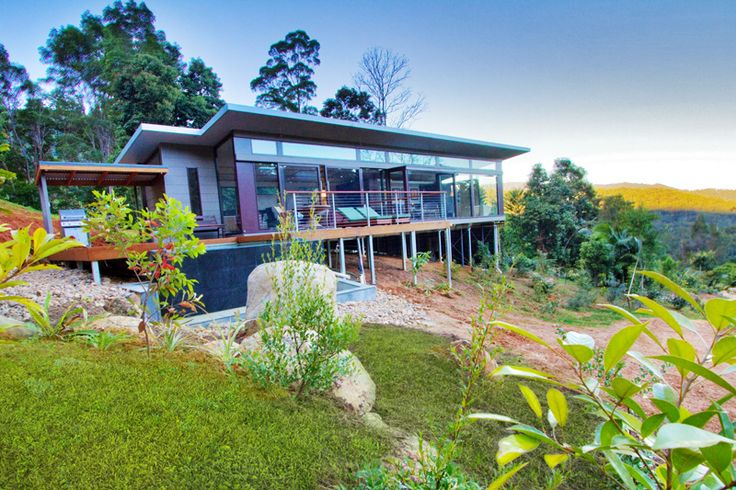 Sloping block house designs and a white picket fence for Block home designs