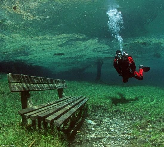 Sublime. Austria's Green Lake in the Hochschwab Mountains is a hiking trail in the winter. However, when the snow quickly melts in early summer it creates a completely clear lake. The lake has a grassy bottom, complete with underwater trails, park benches, and bridges to explore!