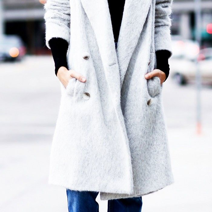 Stay warm this holiday season in a fuzzy grey coat.