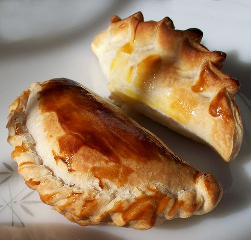 Empanadas de humita are typically filled with a mixture of corn and a ...