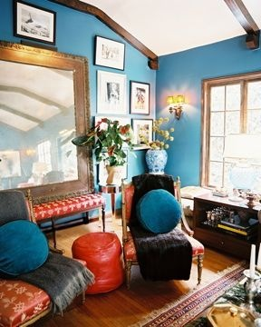 Teal walls, wood trim. in tv room