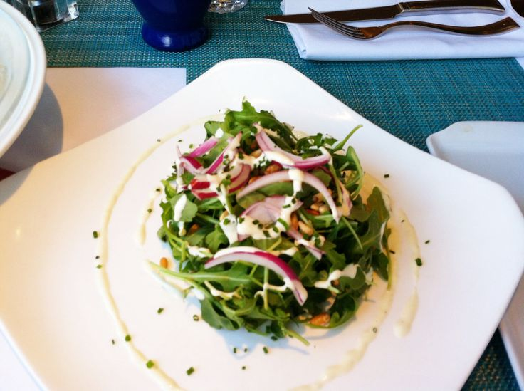 Arugula salad with pine nut, red onion and Gorgonzola cheese