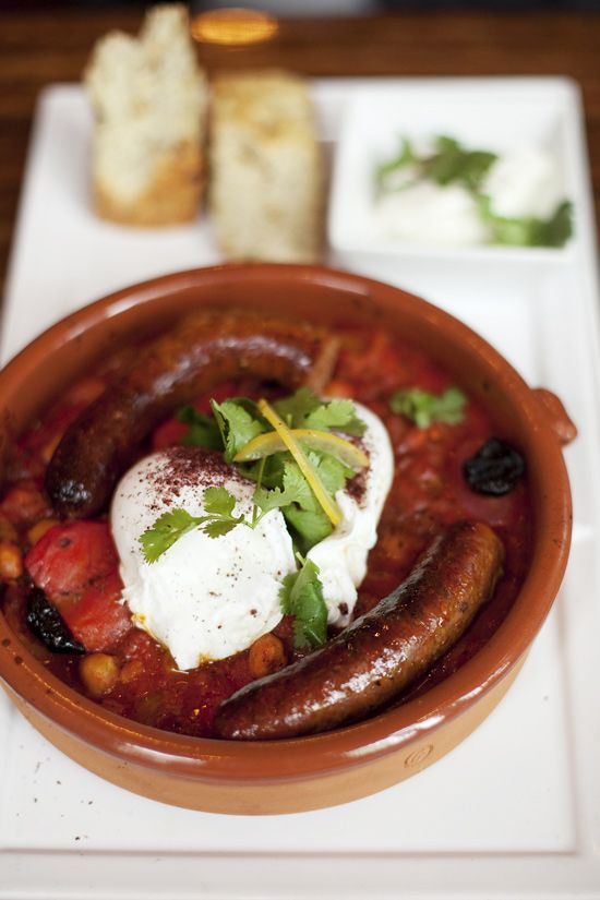 - poached eggs in a spicy tomato stew with Merguez sausage, Moroccan ...