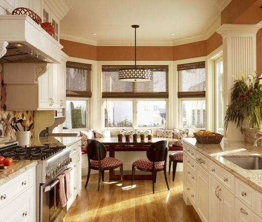 Traditional Galley Style Burnt Orange kitchen, white cabinets, Kathy