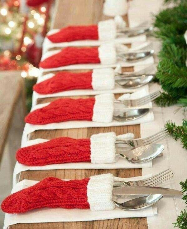 Christmas dinner silverware tucked into small Christmas stockings.