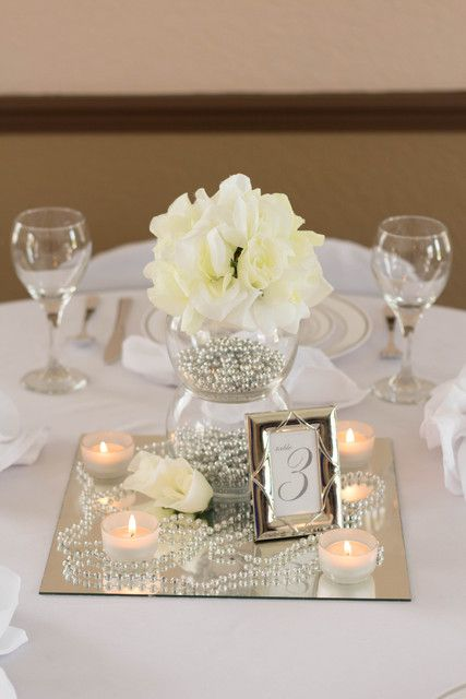 White, Ivory, Silver Wedding Party centerpiece!  See more party ideas at CatchMyParty.com!