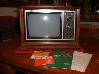 "1960s salesman sample RCA console television with promotional brochures -- 14"" wide x 10.5"" tall x 7"" deep with 9"" diagonal screen."