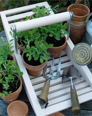 Handmade garden trugs from Geoffrey Fisher.