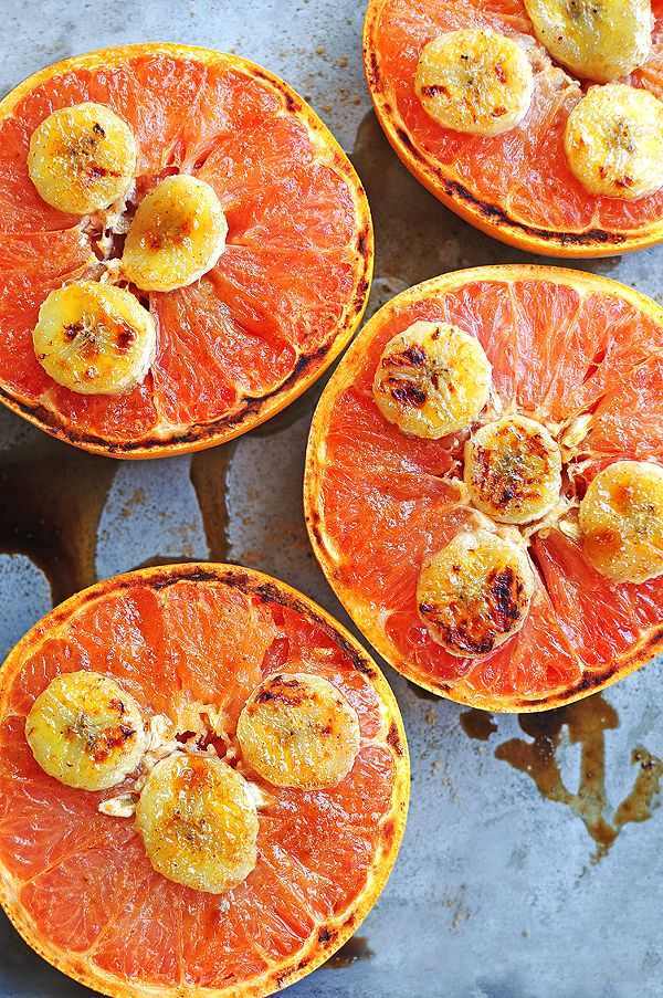 Broiled Grapefruit with banana slices and drizzled honey /