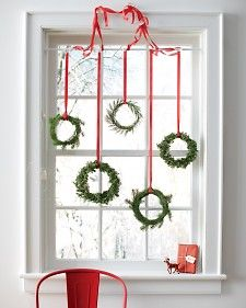 To make, cut sprigs of greenery (we used spruce, cedar, and juniper) and hot glue around an embroidery hoop. Repeat to cover the front and back of the rings, and adhere smaller pieces to the inside of the hoops as needed. Loop a length of ribbon or seam binding around each wreath, and hang.