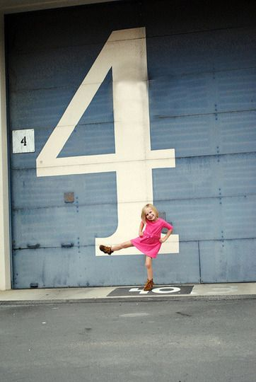 I like this idea - photographing a child in front of a number to show how old they are...