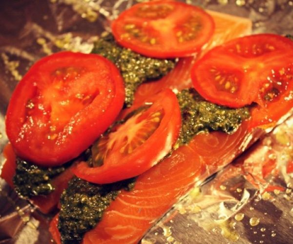 Salmon topped with pesto and tomatoes baked in foil. Recipe by Poppa ...