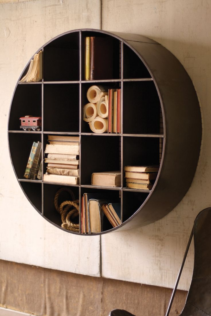 $399 Love this cubby - cool way to bring storage up and J more floor space . . . this would be a statement on the wall across from the window, and place simple IKEA shelves as a desk underneath/span the wall . . . can draw out