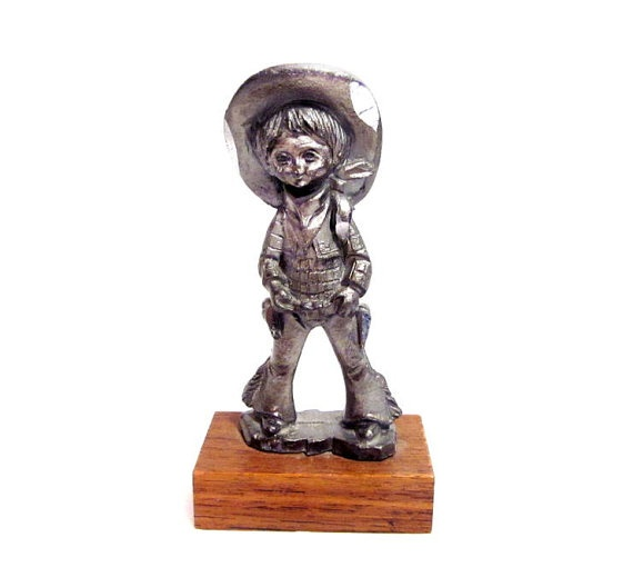 Vintage Pewter Cowboy Figurine.  block of wood