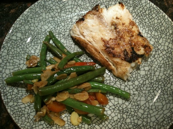 Nile perch fillet with green beans, cherrie tomato and almonds ...
