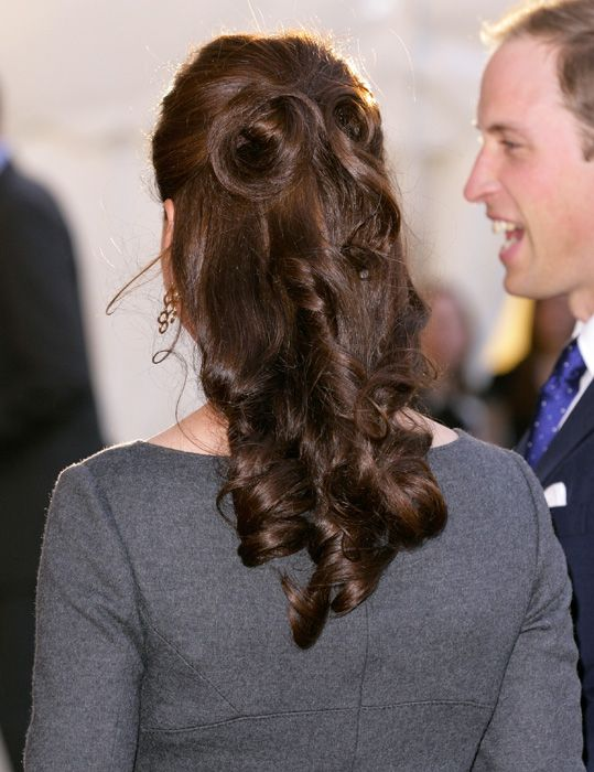 Her hair always looks perfect, but I especially love the demi-chignon on her