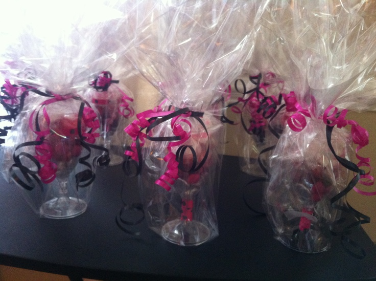Hand decorated wine glasses with candies - bridal shower gifts