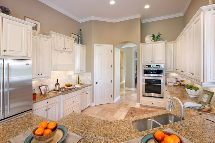 White kitchen with beige granite home decor pinterest for Beige kitchen cabinets wall color