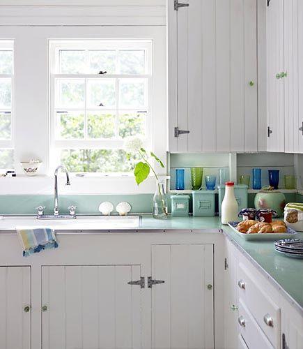 white + aqua. beadboard cabinets??