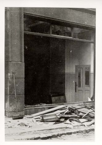Munster, Germany, people standing next to the shattered windows of