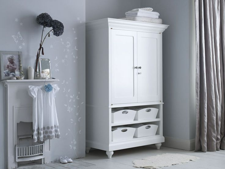Introduce white into a nursery through furniture and storage.