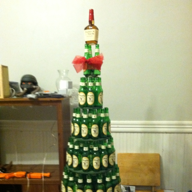 Boozy christmas beer bottle tree holidays pinterest for How to make a beer bottle christmas tree
