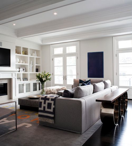 Beautiful living room with white bookcases and eclectic almost southwest inspired design elements