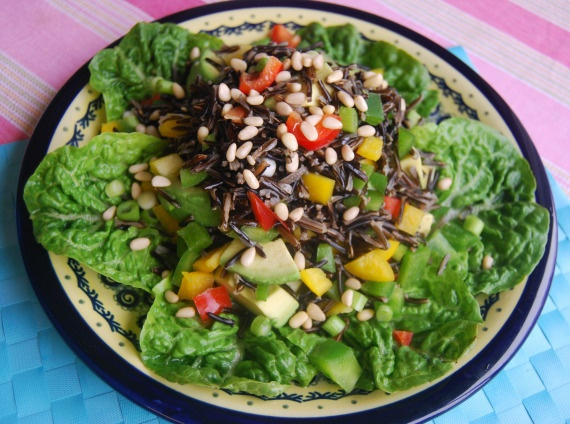 Wild rice salad with pine nuts and avocado (spring onions, peppers ...