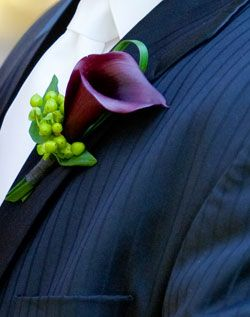 Mini Calla Lilies come in a variety of colors, and with a little Hypericum tucked in, as shown here, are a great size for boutonnieres. Shop Mini Calla Lilies, Hypericum, and other beautiful wedding flowers at GrowersBox.com!