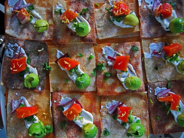 DIY smoked salmon on spicy avocado nachos.