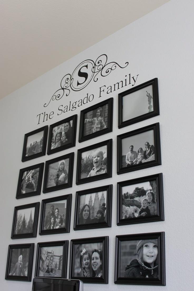 Wall picture arrangement under vinyl lettering