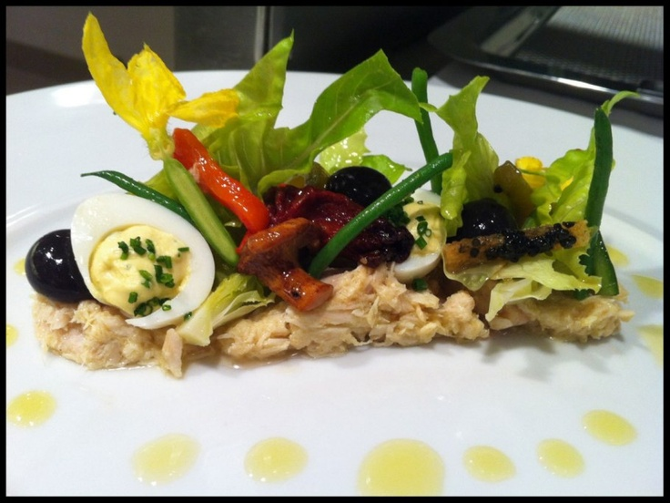 ... romaine hearts, deviled quail egg, caviar, and liquid black olive